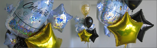 Black and gold giant helium balloon bouquet