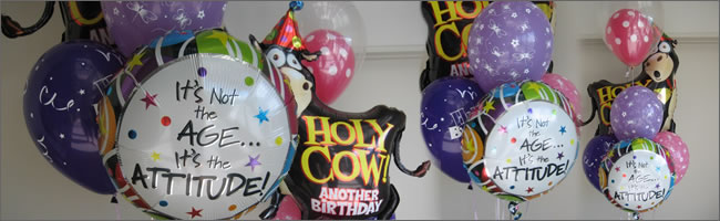 Comic balloon bouquet with Holy Cow and It's not the age , it;s your attitude balloon bouquet